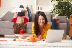 Teenage girls studying at home smiling Royalty Free Stock Images