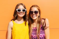 Teenage girls in summer clothes hugging outdoors Stock Images