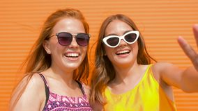 Teenage girls in sunglasses showing thumbs up. Summer fashion, eyewear and people concept - smiling teenage girls in sunglasses outdoors showing thumbs up stock video footage