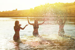 Teenage girls in swimsuits Stock Images