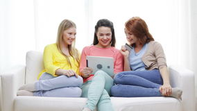 Teenage girls with tablet pc and credit card Royalty Free Stock Image