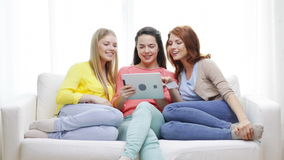 Teenage girls with tablet pc and credit card Royalty Free Stock Images