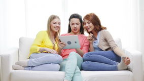 Teenage girls with tablet pc and credit card stock video footage