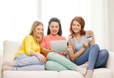 Teenage girls with tablet pc and credit card Stock Photography