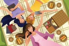 Teenage girls taking selfie while lying down Royalty Free Stock Image