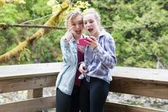 Teenage girls taking a selfie royalty free stock photography