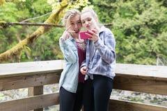 Teenage girls taking a selfie stock images