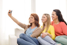 Teenage girls taking selfie with smartphone Royalty Free Stock Images