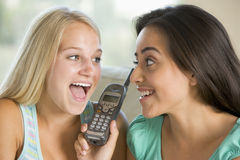 Teenage Girls Talking On Telephone Stock Image