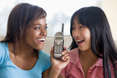 Teenage Girls Talking On Telephone Royalty Free Stock Images