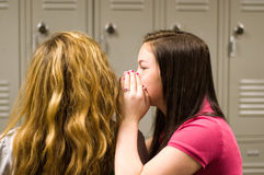 Teenage girls telling secrets Royalty Free Stock Image