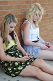 Teenage girls text messaging stock image