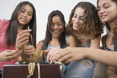 Teenage girls and their jewelry. Royalty Free Stock Photo