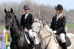 Teenage girls and tired horses Stock Photo