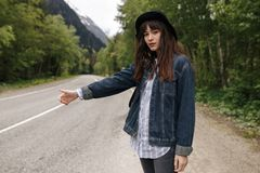 Teenage girls travel and wait on road royalty free stock photos