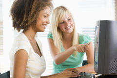 Teenage Girls Using Desktop Computer Stock Photo