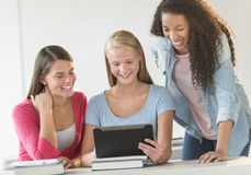 Teenage Girls Using Digital Tablet Together In Classroom Royalty Free Stock Photos