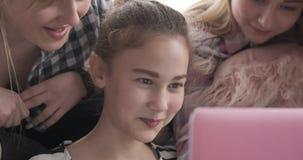 Teenage girls using laptop. Teenage girl friends browsing social media content on laptop stock video footage