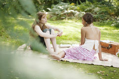 Teenage Girls Viewed Through Leaves Royalty Free Stock Photos