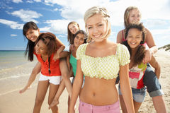 Teenage girls walking on beach. Having fun smiling at camera Stock Photography