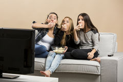 Scared teenage watching movies Stock Photography