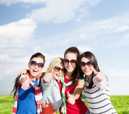 Teenage girls or young women showing thumbs up Royalty Free Stock Photo