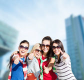 Teenage girls or young women showing thumbs up Royalty Free Stock Image