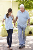 Teenage Granddaughter Helping Grandfather With Shopping Royalty Free Stock Image