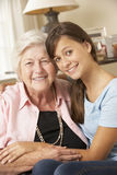 Teenage Granddaughter Visiting Grandmother At Home Royalty Free Stock Images
