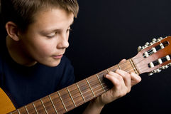 Teenage guitar player Royalty Free Stock Photography