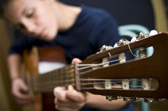 Teenage guitar player. Teenage boy, classic guitar player royalty free stock images