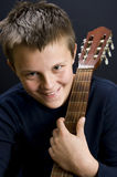 Teenage guitar player. Smiling teenage boy, classic guitar player stock photos