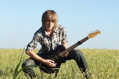 Teenage guitar player posing Royalty Free Stock Image