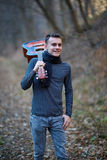 Teenage guitarist outdoor in the forest Stock Images