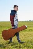 Teenage guitarist outdoor Stock Photos