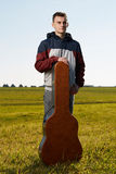 Teenage guitarist outdoor Stock Photography