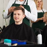 Teenage guy in hairdresser salon Royalty Free Stock Photography