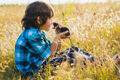 Teenage happy boy playing with rat pet outdoor Stock Image