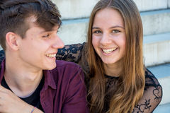 Teenage happy couple smiling Stock Images