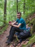 Teenage hiker having a break Royalty Free Stock Photo