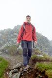 Teenage hiker on mountain Stock Photo