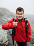 Teenage hiker on mountain Stock Photo