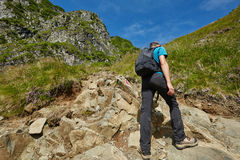 Teenage hiker on mountain trail Stock Images