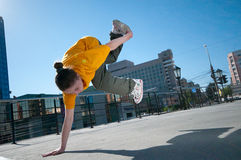 Teenage hip-hop girl dancing over city landscape Royalty Free Stock Image