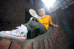 Teenage hip-hop girl on red brick wall Stock Images