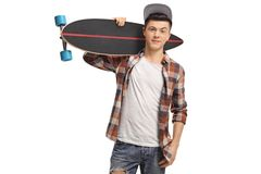 Teenage hipster holding a longboard Stock Image