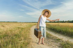 Teenage hitchhiking on country road Royalty Free Stock Photos