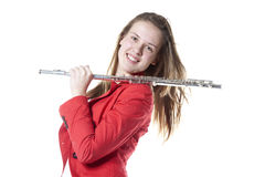 Teenage holds flute in studio Royalty Free Stock Photography