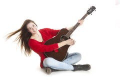 Teenage holds guitar in studio Stock Image