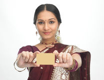 Teenage indian girl with credit card Stock Image